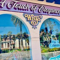 A Touch Of Elegance Wigs logo