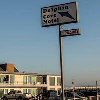 Dolphin Cove Motel logo