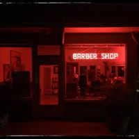 Willie Romero's Barber Shop logo